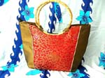 wholesale replica designer handbag fashion. Womens fashion handbag in yellow, stitched design on red, and black
