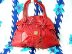 Handbag wholesale distrbutor supply. Red imitation leather purse with double handles and cinch-up top