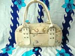 Fashion purse handbag wholesale store. Day purse in cream color with beautiful design and front pocket