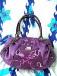 Designer handbag factory distributes Classy evening wear purse in vibrant purple with fun sequin design.